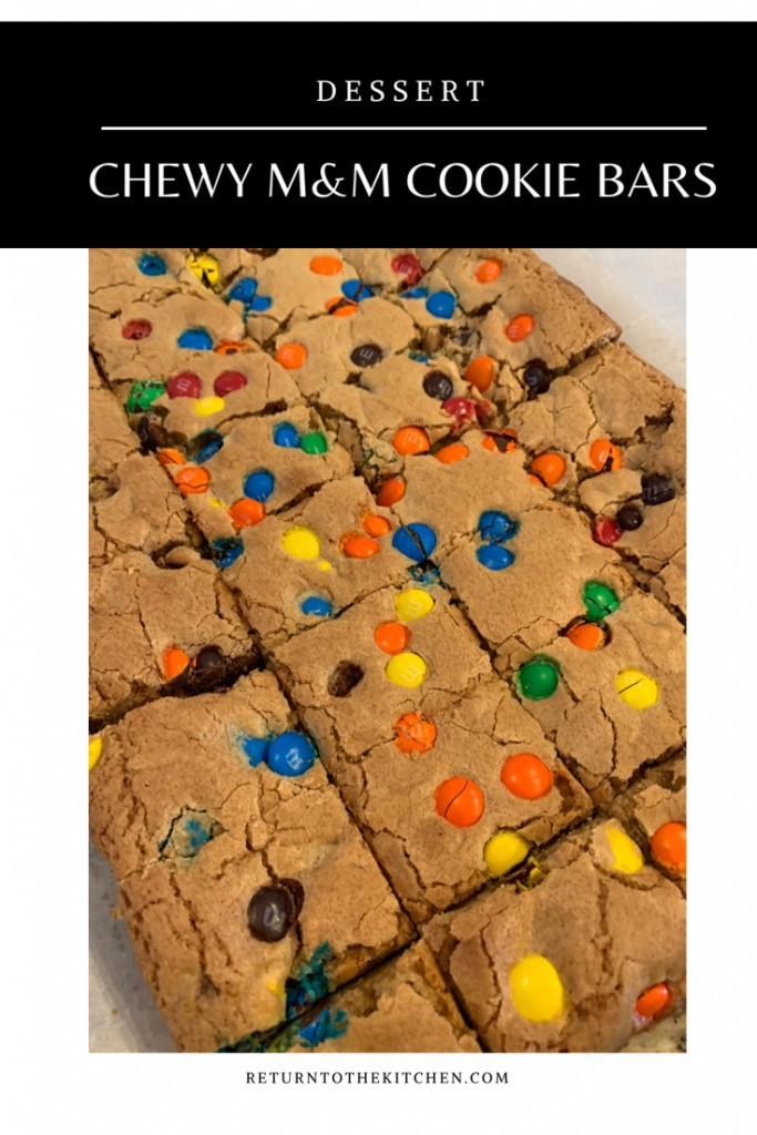 Chewy M&M Cookie Bars sliced into small bars