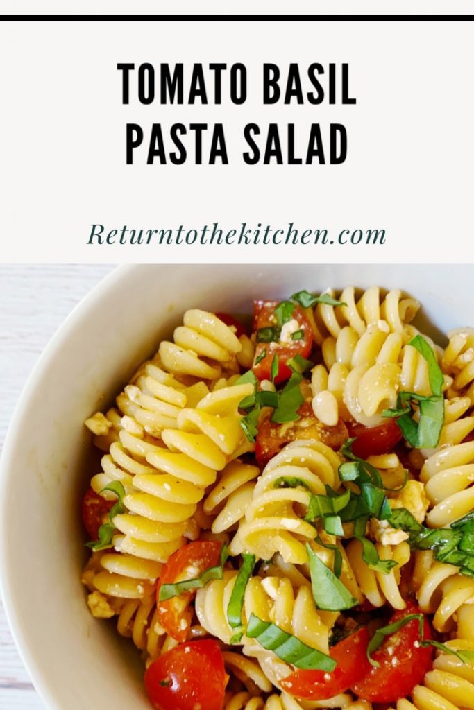 Tomato Basil Pasta Salad in a white bowl close up picture