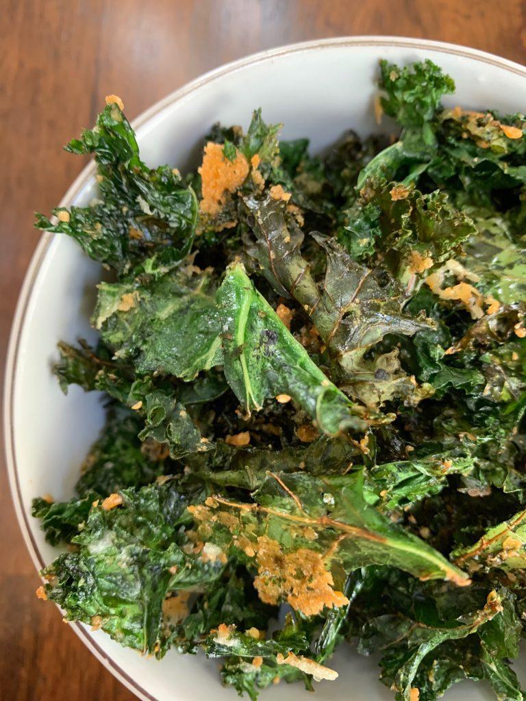 Crunchy Parmesan Kale Chips in a white bowl