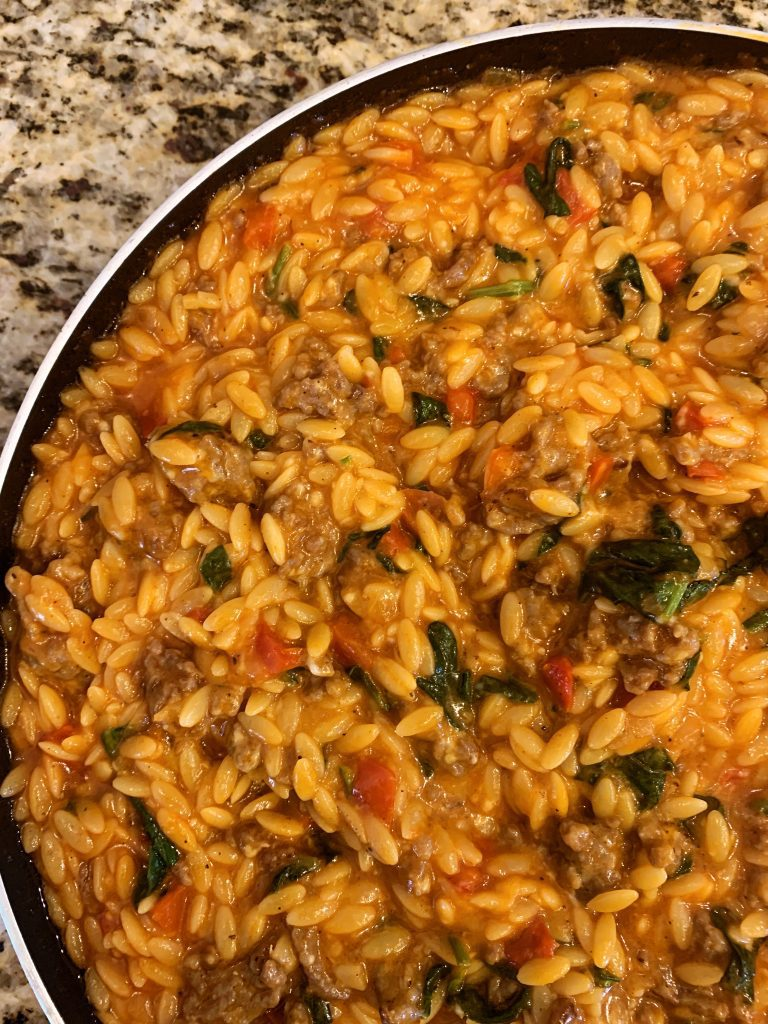 italian sausage orzo in a pan cooked