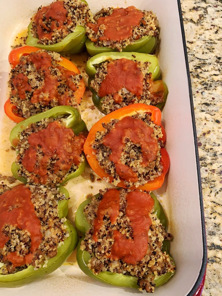 stuffed peppers in a casserole dish