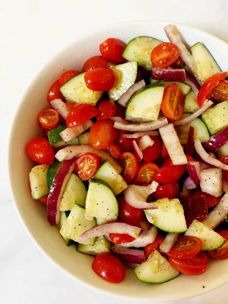 Cucumber Tomato and Onion salad in a white bowl