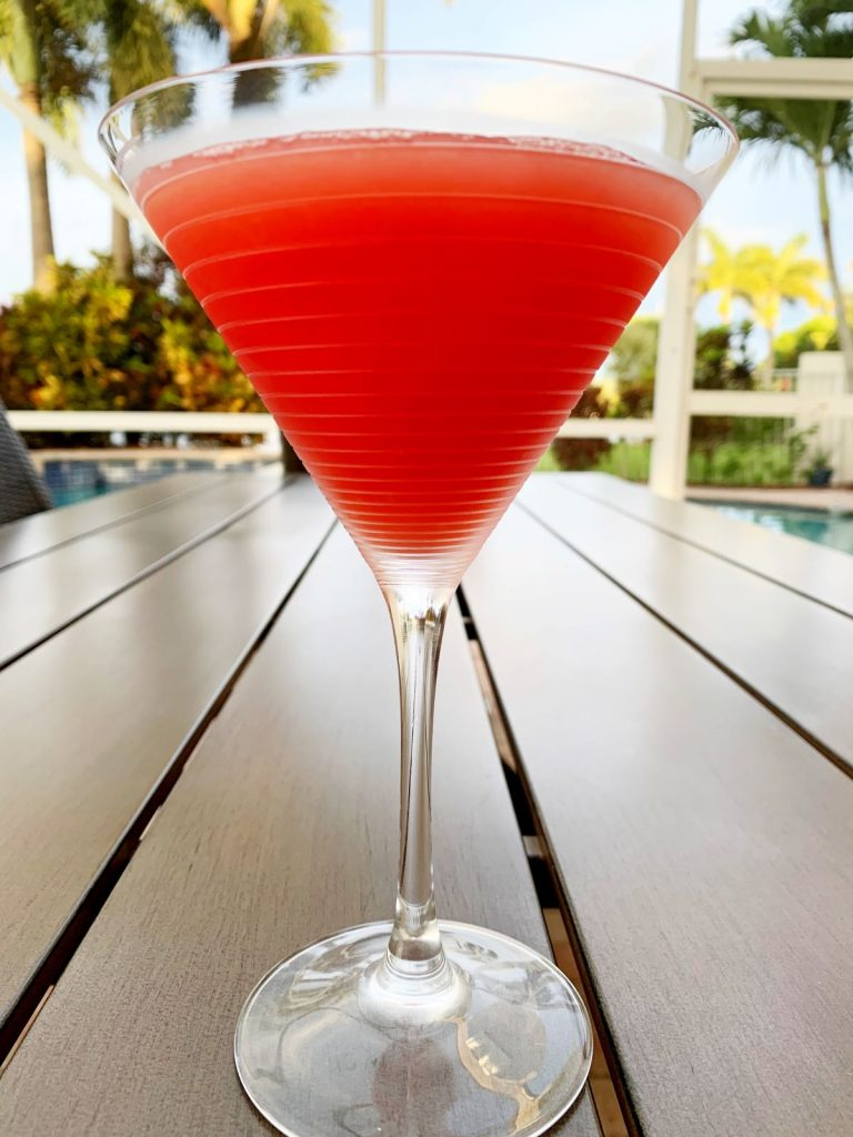 Watermelon Martini in a glass on an outdoor table